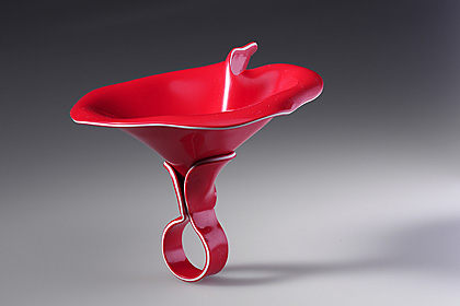 red plastic ring by Pavel Herynek